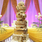 tall gold and cream wedding cake