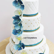 4 tiered blue and white wedding cake
