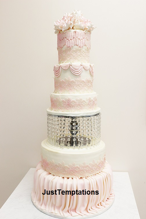 tall white and pink wedding cake