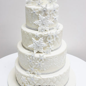 white wedding cake with snowflakes