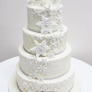 white wedding cake with snowflakes