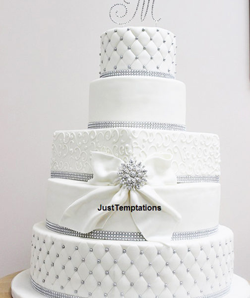 white wedding cake with pearl details