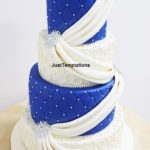 blue and white sashe wedding cake