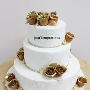 white cake with gold flowers