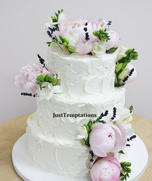 3 tiered butter cream floral wedding cake