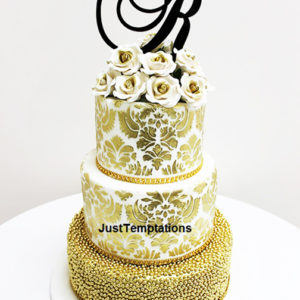 gold confetti 3 tiered wedding cake
