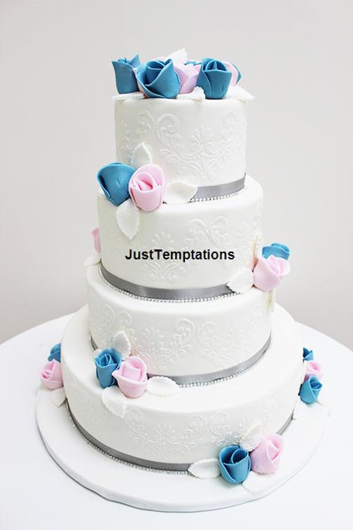 white wedding cake with pastel flowers