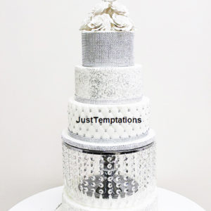 silver and white wedding cake with pearls