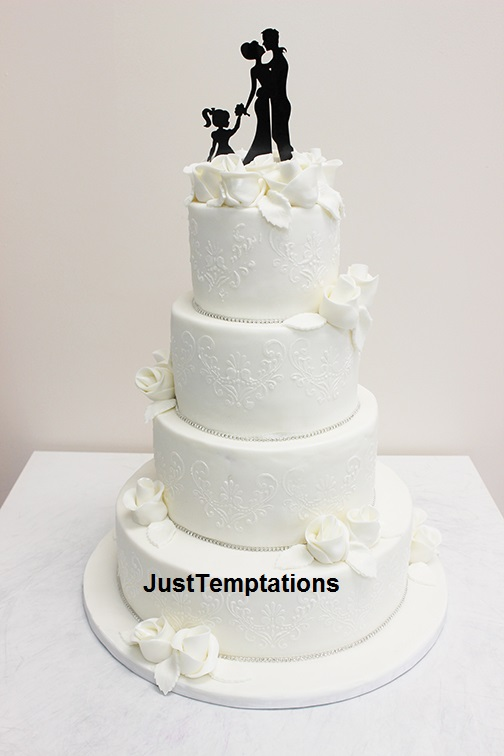 4 tiered white wedding cake