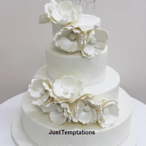 white floral 3 tiered wedding cake