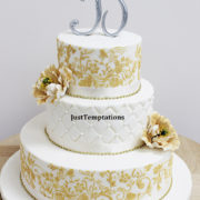 3 tiered gold and white wedding cake