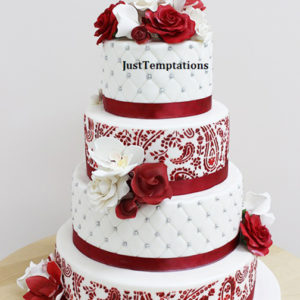 4 tiered white and red cake with pearls