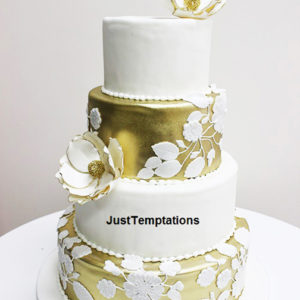 gold and white 4 tiered wedding cake