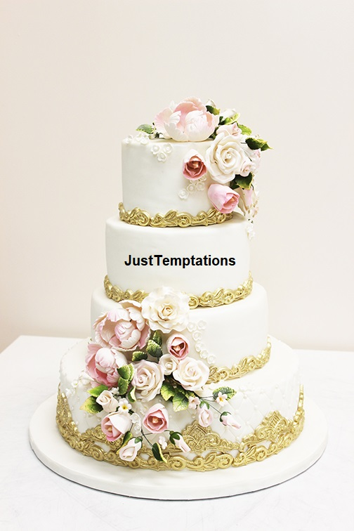 gold wedding cake with pink flowers