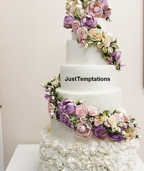multi-colored floral wedding cake