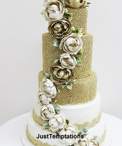 gold confetti and floral wedding cake