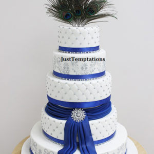 white and blue wedding cake with feathers