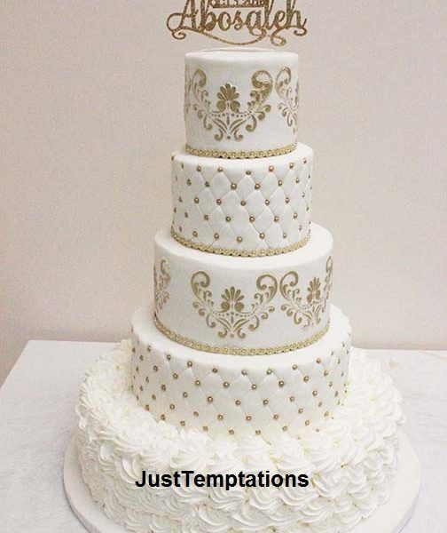 5 tiered white and gold wedding cake