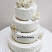 cream wedding cake with gold details