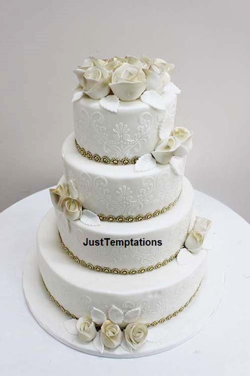 cream wedding cake with gold details