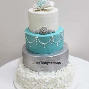 4 tiered silver white and teal wedding cake