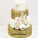 gold confetti and white wedding cake
