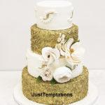 gold confetti and white wedding cake