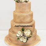 sprayed peach wedding cake