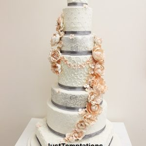 tall wedding cake with peach flowers