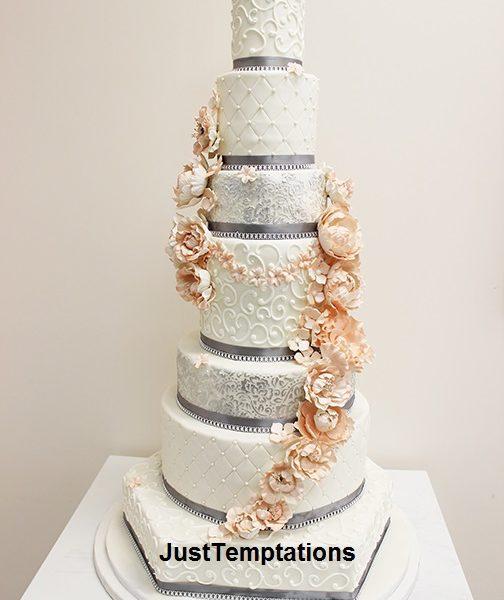 tall wedding cake with peach flowers