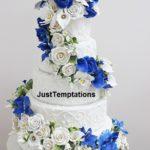multi-colored flowers on wedding cake
