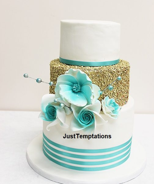 gold confetti and blue wedding cake