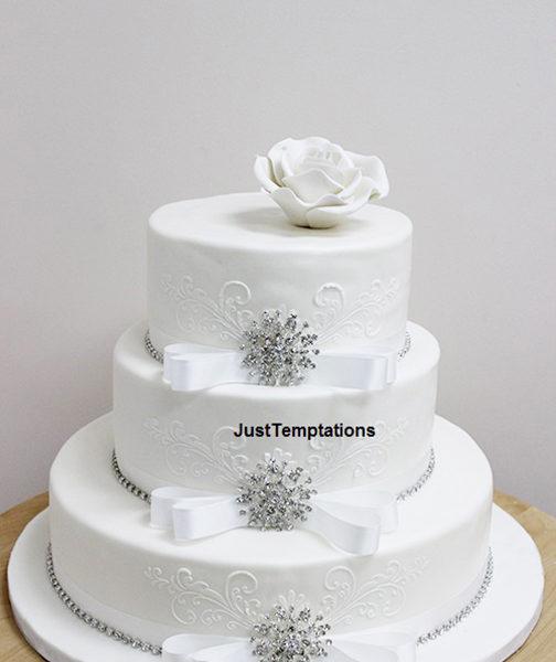 3 tiered white wedding cake