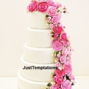 5 tiered cream wedding cake with pink flowers
