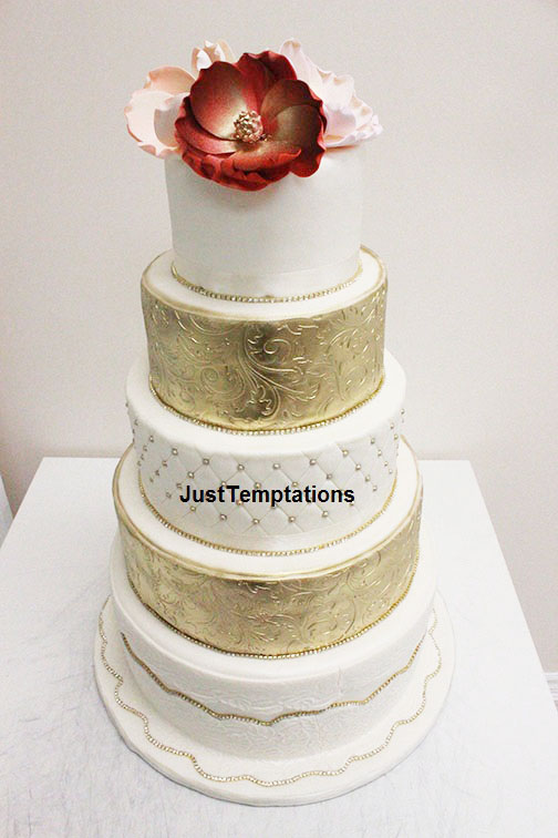 5 tiered gold and white wedding cake