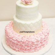 pink and white 3 tiered wedding cake