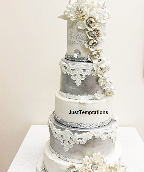silver and white 5 tiered wedding cake