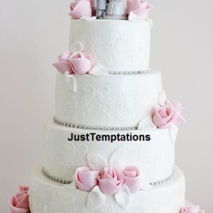 white wedding cake with pink