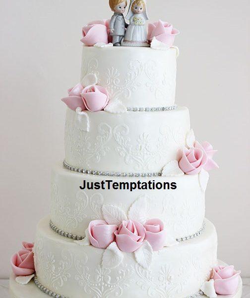 white wedding cake with pink