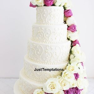 5 tiered pearl white and floral wedding cake