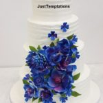 white wedding cake with blue flowers
