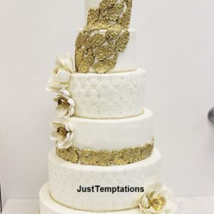 6 tiered white cke with gold decorations