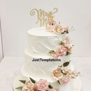 butter cream 3 tiered floral wedding cake