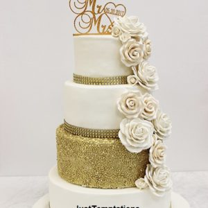gold confetti and cream floral wedding cake