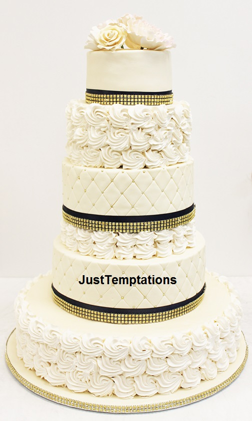 5 tiered cream wedding cake