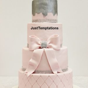 4 tiered pink wedding cake with bow