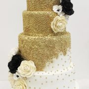 gold confetti with flowers wedding cake