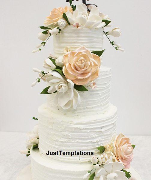 peach and white 4 tiered wedding cake