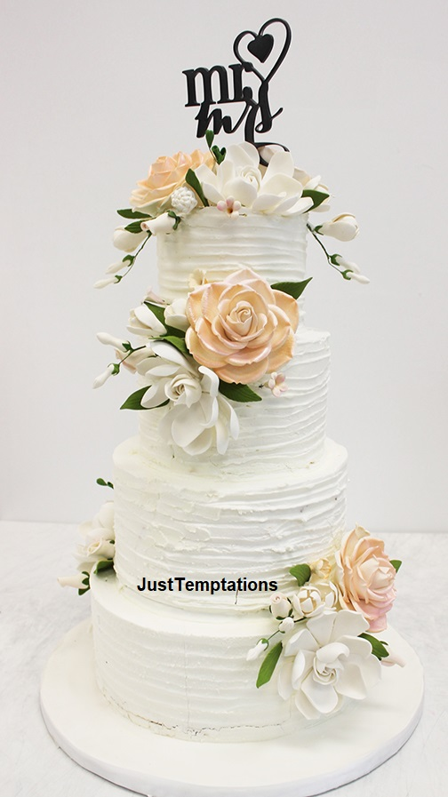 peach and white 4 tiered wedding cake