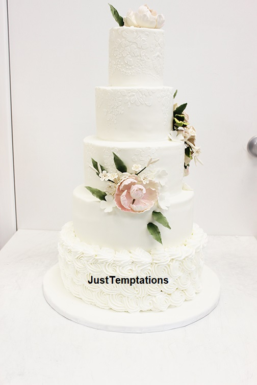 cream 5 tiered wedding cake